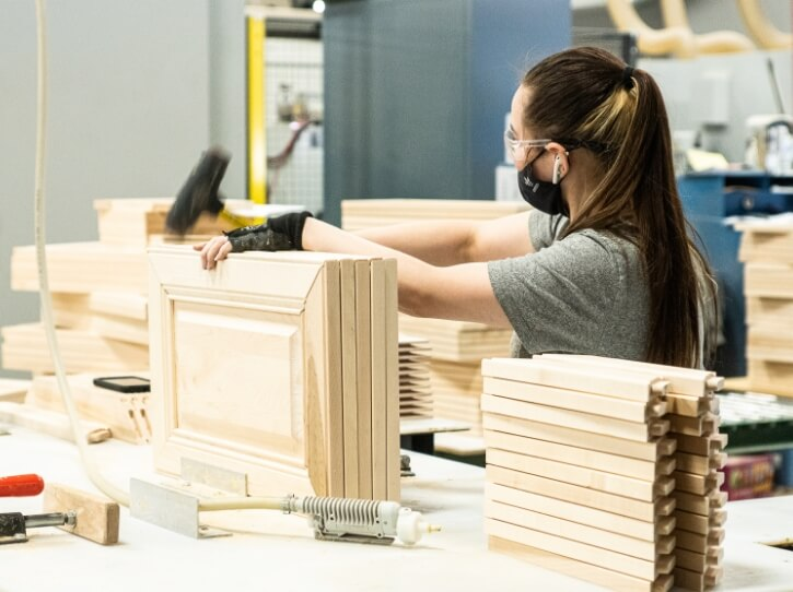 Woman creating wood cabinetry