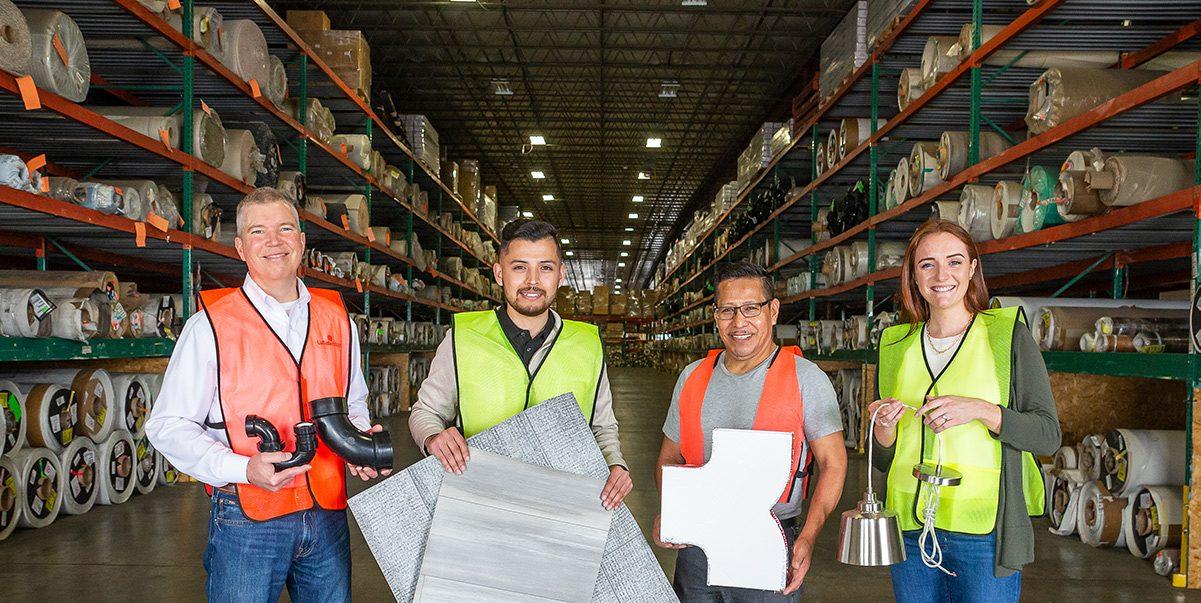 Patrick team members holding products in warehouse