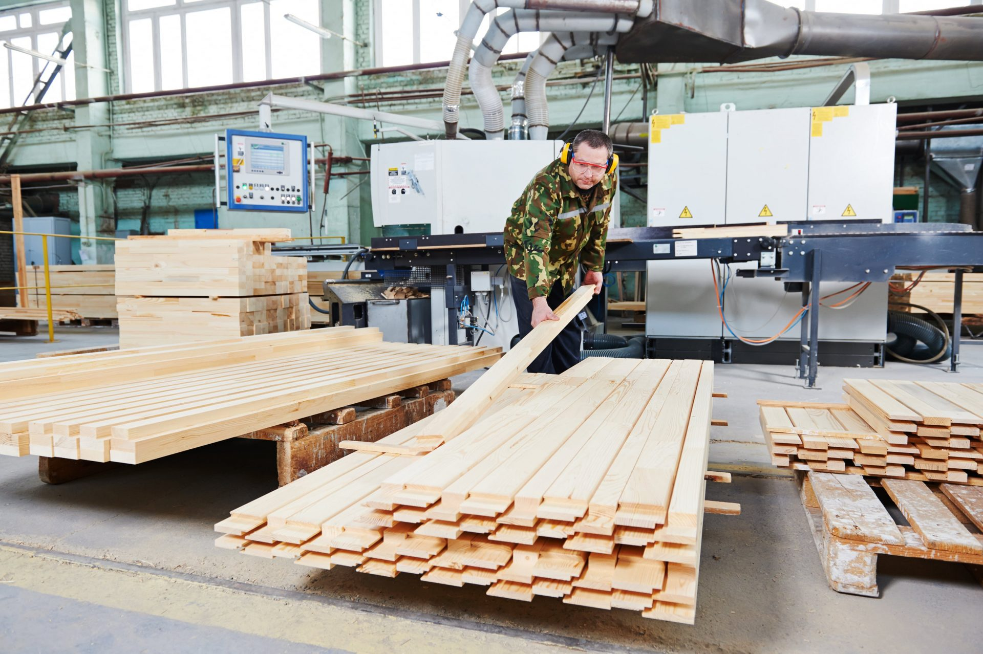 Man stacking wood in Patrick warehouse